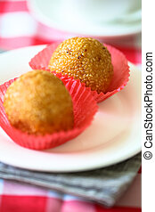 Sesame Seed Balls - Sesame seed balls on the white plate.