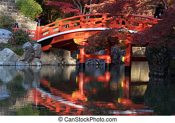 Japanese bridge in fall - A traditional japanese wooden...