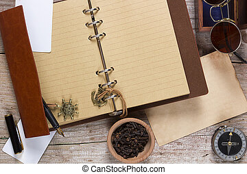 Clove spice and note pad on an old wooden table