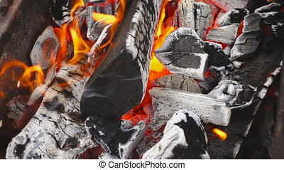 Fanning flames, slow motion - Flames fanned out of...
