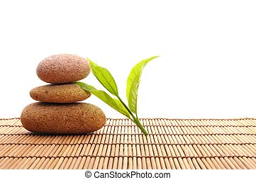 zen stack or tower with green summer leaf showing spa or...