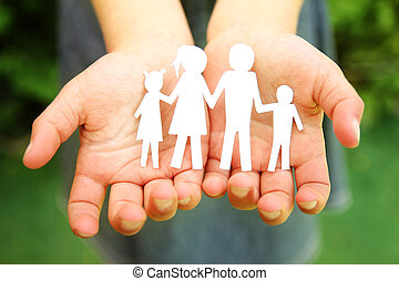 in the hands of the family on a background paper