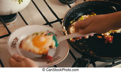 Cook Puts Ready Fried Eggs Onto a Plate - Fried eggs with...