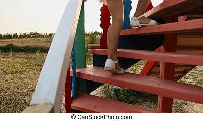 girl climbs the hill