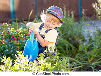 kid boy as gardener
