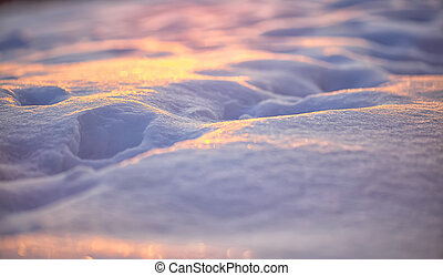 Natural winter background with snow drifts at sunset....