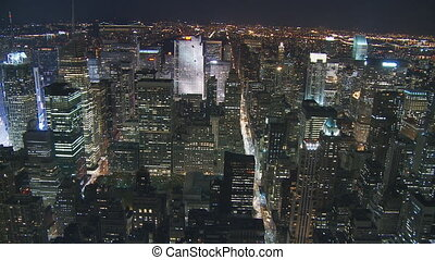 lights of manhattan - aerial view over manhattan by night