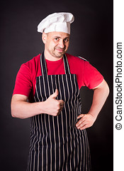 Portrait of a cook man in the studio - Portrait of a cook...