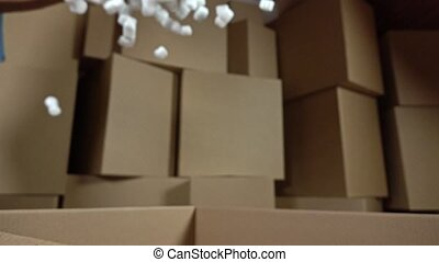 Falling soft polystyrene pieces. Shockproof packaging...