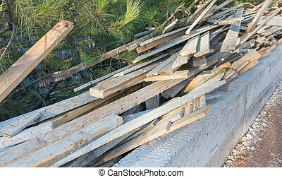 Construction wooden beams - A pile of wooden beams on a...