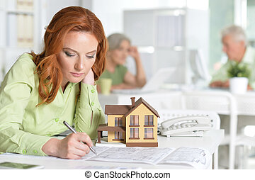 working Female house agent - Portrait Of working Female...