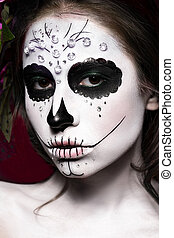 Woman in Halloween makeup - mexican Santa Muerte mask....