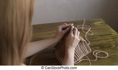 Knitting long-haired woman - Beautiful young blonde...