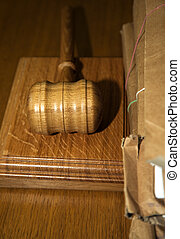Hammer in the court - table in the courthouse.