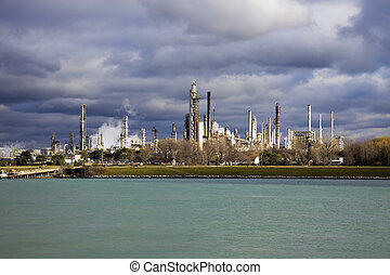 Refinery in Canada seen across the border river from Port...
