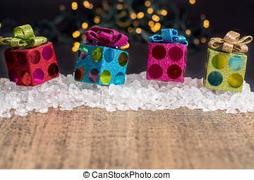 Christmas decoration, colorful gift boxes on chrystal ice...