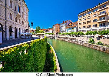 Green Ljubljanica riverfront in Ljubljana, capital of...