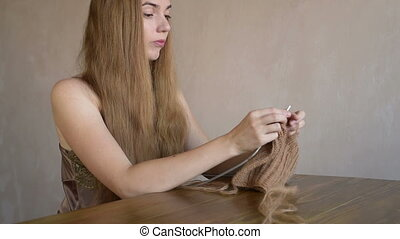 Woman with long blonde hair knitting - Beautiful young...