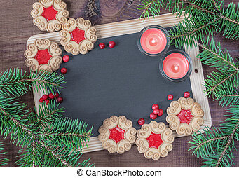 Christmas creative background - Blank chalkboard surrounded...