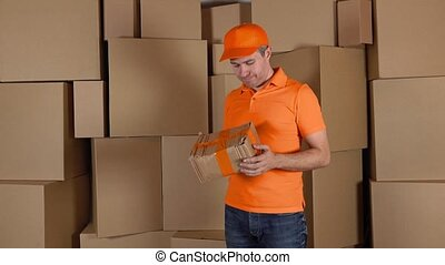 Delivery man in orange uniform delivering damaged parcel to...
