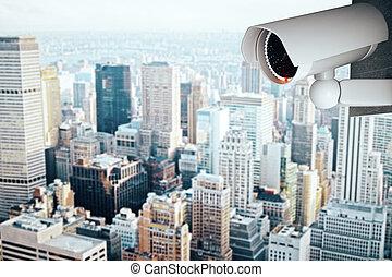 Security camera on modern city background