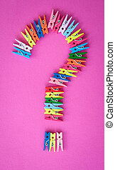 Colorful clothes pegs on pink - Little colorful clothes pins...