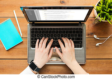 close up of woman or student typing on laptop - programming,...