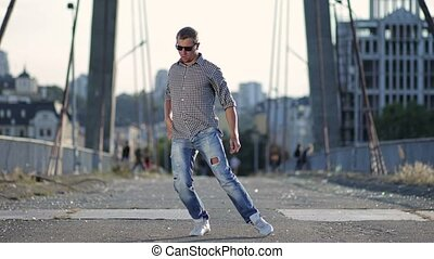 Urban dancer showing some movements - Urban dancer in jeans...