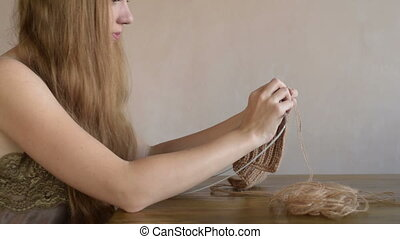 Woman with long hair knitting - Beautiful young blonde...