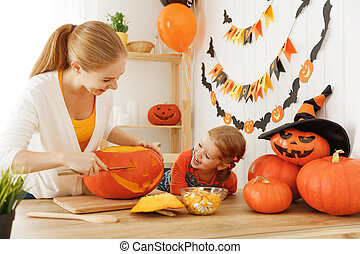 family mother and child daughter are preparing for Halloween...