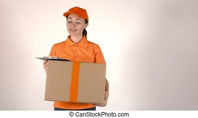 Girl courier in orange uniform delivering big cardboard...