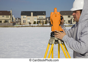 Land surveying during the winter - suburban area
