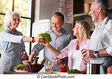 Joyful family cooking dinner all together in the kitchen -...
