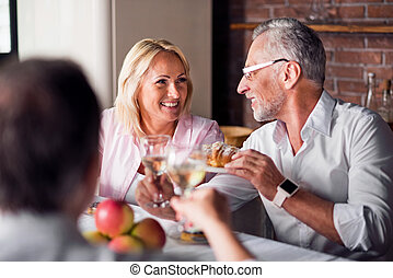 Two nice people chatting at dinner table - Charming smile....