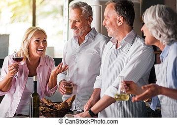 People having cooking party in kitchen of a house -...