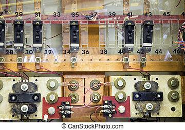 Breaker panels in power plant on cellular site.