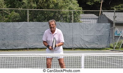 senior tennis player practice - senior tennis player...
