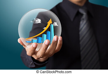Hand holds the chart of growth in crystal ball
