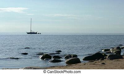 Yacht near coast - Yacht anchored near sandy beach coast...