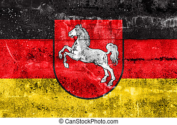 Flag of Lower Saxony, Germany, painted on dirty wall