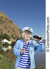 Captain looks through binoculars - The captain on vacation...