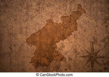 north korea map on vintage crack paper background - north...