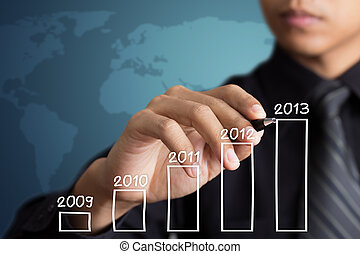 Businessman drawing growth chart