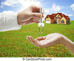 Real estate and mortgage concept - Businessman handing key...