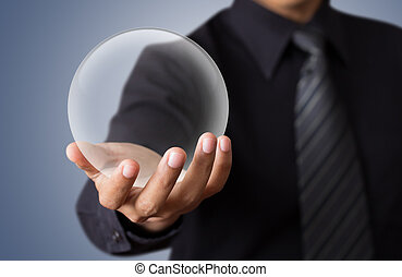 businessman Hand holding a crystal Ball