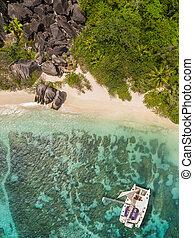Aerial photo of Seychelles beach with catamaran - Aerial...