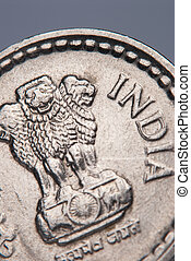 Indian coin - A closeup of a Indian coin - shallow DOF