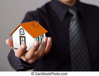home in business man hand