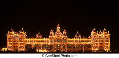 Mysore - A crowd gathers in front of the Mysore Palace, lit...