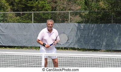 tennis player senior practice - senior tennis player...
